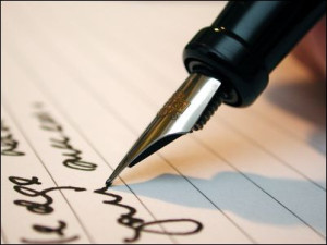 man writing a contract